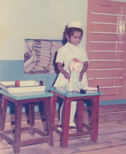 Me, aged 4, as a nurse treating a doll